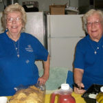 Sisters of Providence Lucy Nolan, left, and Mary Frances Keusal, right, volunteer preparing and serving food for shoppers and helpers at the October rummage sale for Providence Family Services in Chicago.